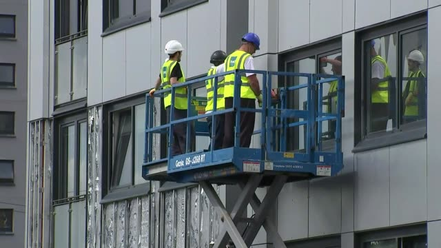 high-rise blocks fail fire safety checks; england: greater manchester: salford: ext various of workers removing cladding from high rise building - removing stock videos & royalty-free footage