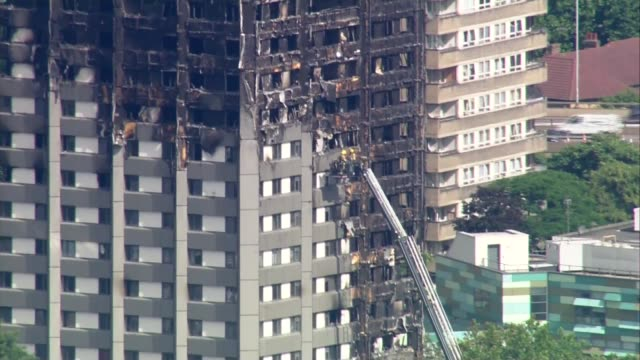 aerials of aftermath ENGLAND London North Kensington Grenfell Tower in aftermath of fire / firefighters around tower / Westfield Shopping Centre