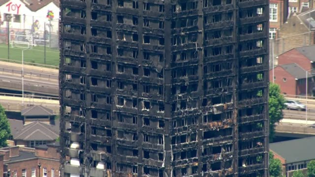 at least 58 people now presumed dead england london north kensington grenfell tower destroyed by fire - itv weekend evening news点の映像素材/bロール