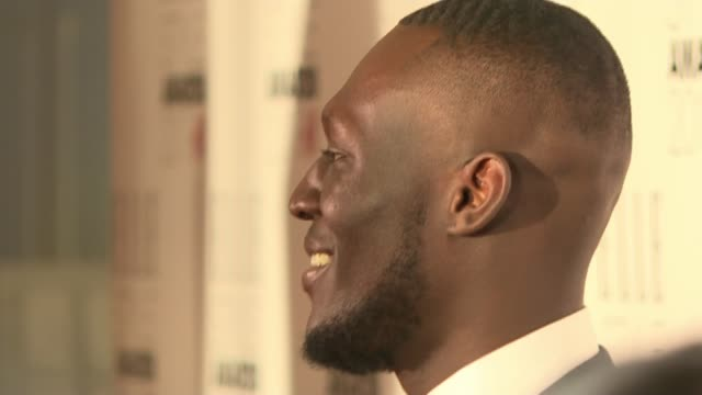 grenfell tower fire charity single released lib stormzy at event - stormzy stock videos and b-roll footage