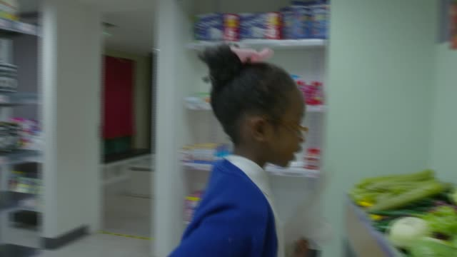 Children from area struggling to return to normality six months on INT Various shots children in pretend supermarket Khalid Dovie interview SOT...