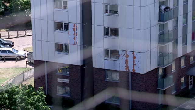 cladding fire safety checks general views of Barnet tower blocks ENGLAND London Barnet EXT View from tower block balcony through netting / general...