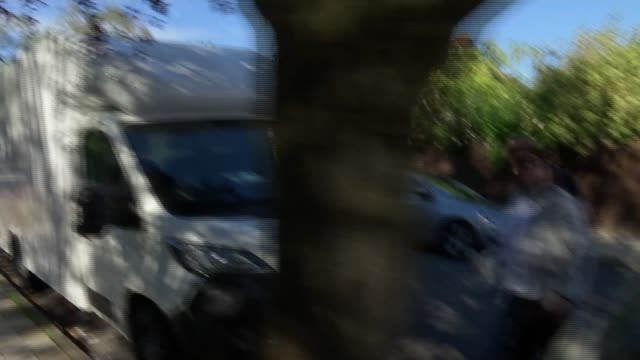 council worker sentenced for spending thousands intended for victims england london isleworth various shots jennny mcdonagh along from car ignoring... - asking stock videos & royalty-free footage