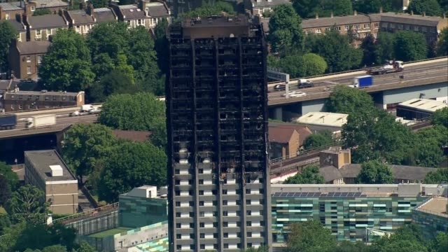 final death toll may not be known until end of year say police june 2016 burnt shell of grenfell tower - jackie long stock videos & royalty-free footage