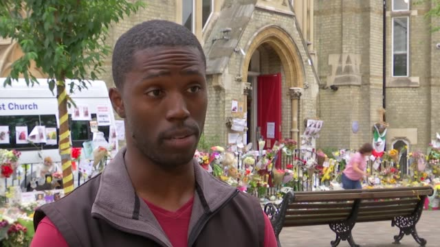 final death toll may not be known until end of year say police; north kensington: ext mervyn akins interview sot - [re grenfell tower fire victims]... - キングスカレッジ点の映像素材/bロール