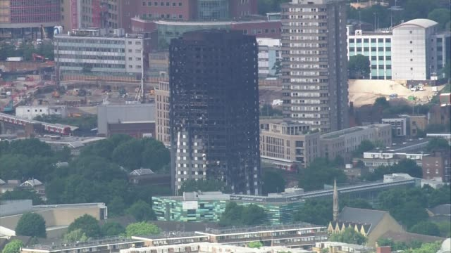 fire investigation work continues / tower block safety england london latimer road grenfell tower and westfield shopping centre firefighters on... - itv放送点の映像素材/bロール