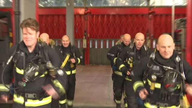 firefighters who tried to save lives at grenfell to run the london marathon member of paddington fire crew putting on full uniform to show what the... - firefighter stock videos & royalty-free footage