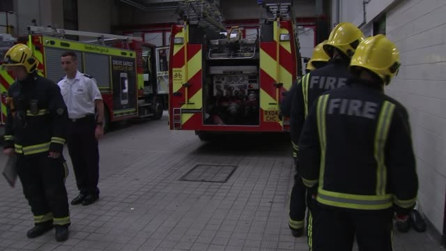 Firefighters who tried to save lives at Grenfell to run the London Marathon INT Various shots Red Watch firefighters lined up Firefighter putting...