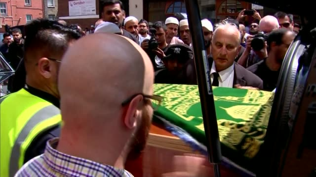 funeral of first named victim mohammed alhajali england london east london mosque ext people along with coffin of mohammed alhajali various shots... - イーストロンドン点の映像素材/bロール