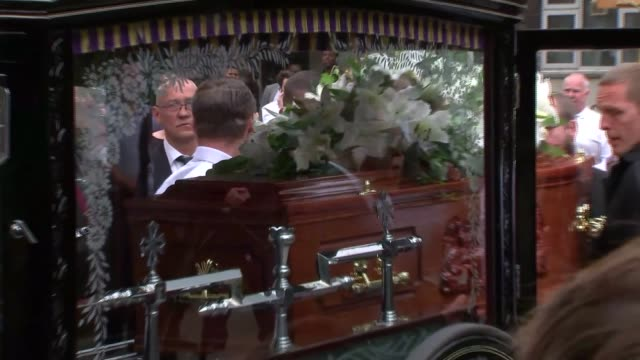 funeral of victim tony disson departures england west london our lady of the holy souls church ext church / pallbearers carrying coffin of tony... - hearse stock videos & royalty-free footage