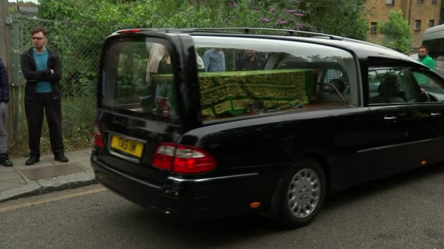 funerals of victims take place / review of tower block safety ordered england london ext various shots of hearses along leaving mosque - hearse stock videos & royalty-free footage