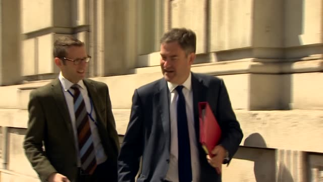 Government meets to create task force ENGLAND London Whitehall EXT People along into Whitehall / Jeremy Hunt MP along into the cabinet office / David...