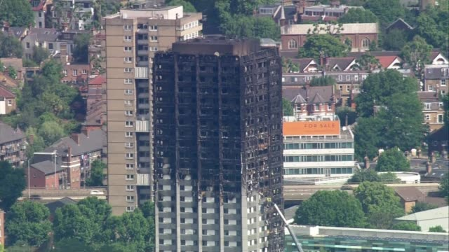 government promises review on banning flammable cladding after grenfell tower report backlash; 16.6.2017 / r160617006 england: london: north... - flammable stock videos & royalty-free footage