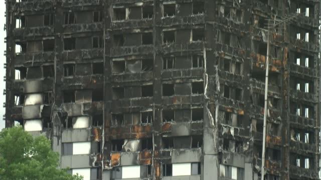 government promises review on banning flammable cladding after report backlash; t13071730 / grenfell tower: burnt out shell of grenfell tower with... - flammable stock videos & royalty-free footage