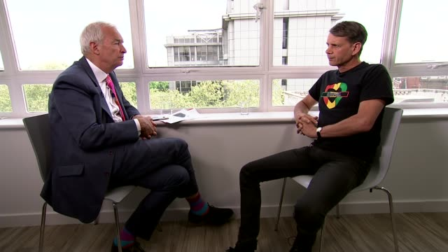 grenfell inquiry begins: grenfell activist edward daffarn interview; england: london: int reporter and eddie daffarn as reporter asks question sot... - asking stock videos & royalty-free footage