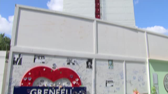 grenfell inquiry firefighter gives testimony of listening to victims die over the phone england london north kensington ext grenfell tower heart sign... - ジャッキー ロング点の映像素材/bロール