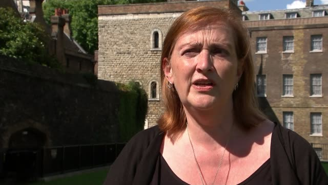 Grenfell Inquiry to examine authorities' response and 'adequacy' of fire regulations Kensington Taxi along road with burnt shell of Grenfell Tower in...