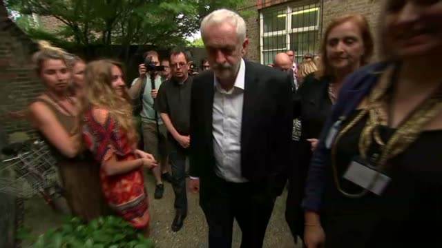 Jeremy Corbyn visit Labour Party leader Jeremy Corbyn meeting people / INT Corbyn meeting people in church where donations for the victims of the...