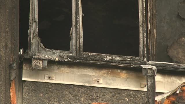 Leaked report says refurbishment 'turned tower into fire hazard' T13071730 T28071733 North Kensington Various shots of charred exterior of...