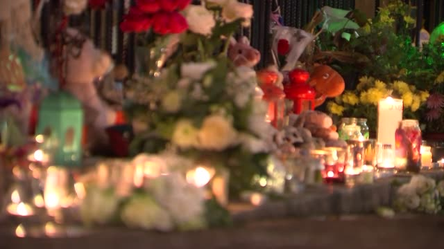Local community reflects on six month anniversary ENGLAND London Various shots candles and floral tributes left for Grenfell victims six months after...