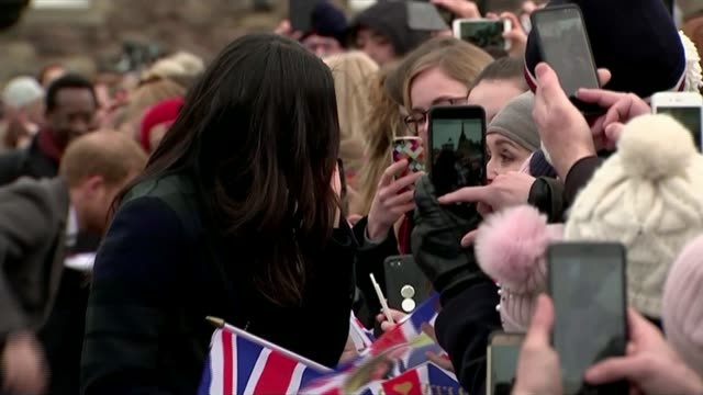 meghan markle has visited local mosque scotland edinburgh ext union jack flags with portrait of prince harry and meghan markle in middle tilt up... - edinburgh stock videos and b-roll footage