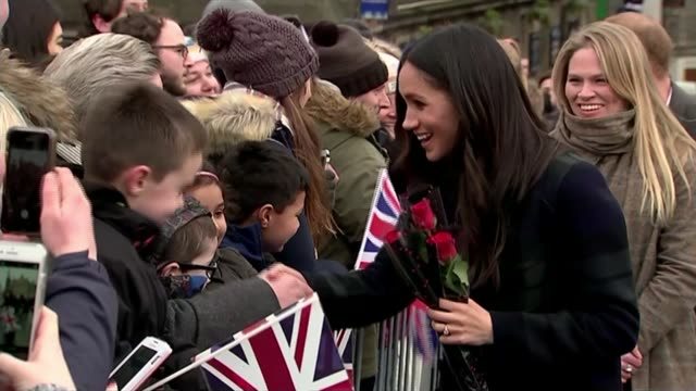 Meghan Markle has visited local mosque SCOTLAND Edinburgh EXT Meghan Markle greeting children in crowd as being given red roses Crowd holding Union...