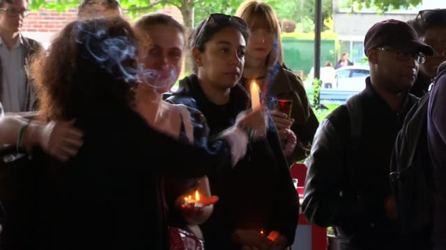 Minute's silence to mark 100 days since the fire ENGLAND London North Kensington EXT Various shots vigil to mark 100 days since Grenfell Tower fire...