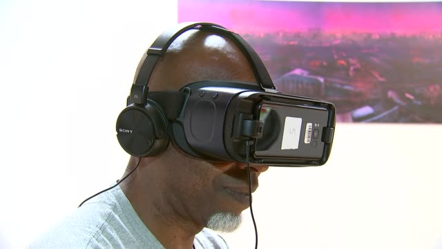 New documentary shows life in Grenfell Tower before the fire ENGLAND London INT Leroy Smith wearing virtual reality headset and headphones as...