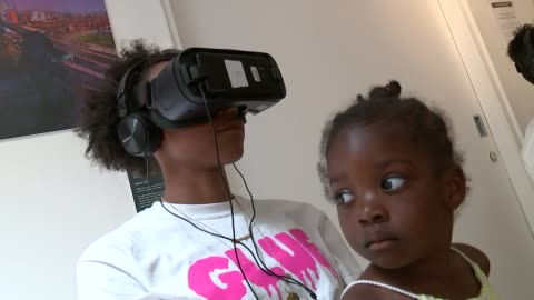 grenfell tower fire: new documentary shows life in grenfell tower before the fire; england: london: int joelle mitchell wearing virtual reality... - smith tower stock-videos und b-roll-filmmaterial