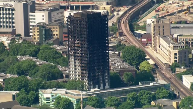 offical number of missing presumed dead rises to 79 kensington burnt out shell of grenfell tower - jackie long stock videos & royalty-free footage