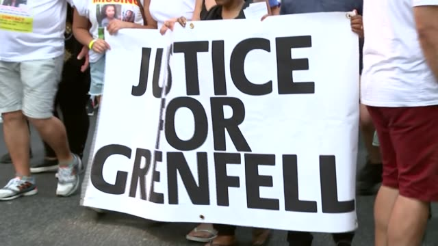 offical number of missing presumed dead rises to 79; london: people marching along road 'justice for grenfell' banner held by protesters as along... - marching stock videos & royalty-free footage