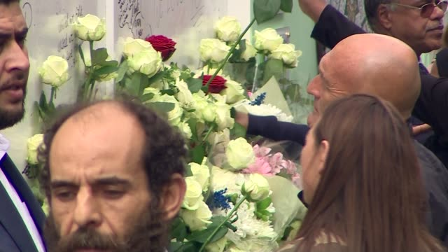 alternative angle and cutaway shots memorial outdoor service england london west kensington latimer road ext cutaways shots of people milling about... - stormzy stock videos and b-roll footage