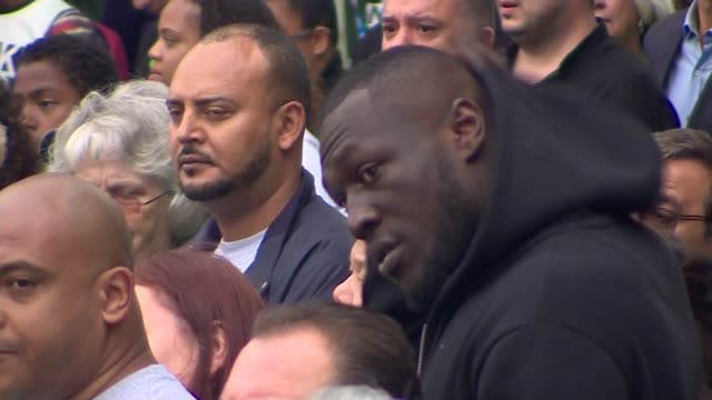 alternative angle and cutaway shots memorial outdoor service england london west kensington latimer road angle shots of grenfell tower fire one year... - stormzy stock videos and b-roll footage
