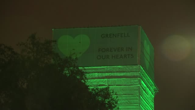 day of commemorations UK London Grenfell Tower fire anniversary buildings illuminated with green light 10 Downing Street London Eye Larry the cat...