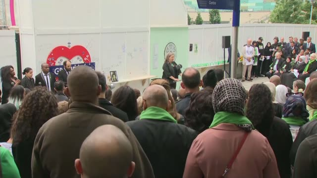day of commemorations england london north kensington ext woman reading names of grenfell tower fire victims sot various shots people standing for... - stormzy stock videos and b-roll footage