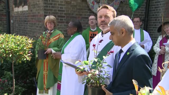 one year anniversary garden of peace and healing dedicated england london kensington st clements church ext procession out of church for garden of... - bishop of london stock videos & royalty-free footage