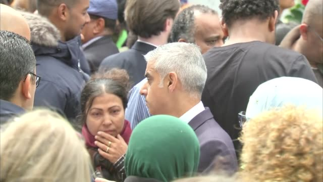 memorial outdoor service wreath laying at memorial wall england london north kensington latimer road ext general views of grenfell tower fire one... - stormzy stock videos and b-roll footage