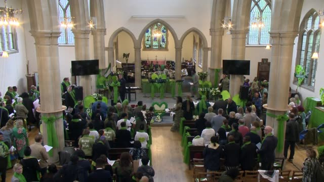 grenfell tower fire one year anniversary: memorial service at st helen's church; england: london: kensington: st helen's church: int one year... - choir stock videos & royalty-free footage