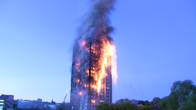 overnight general views; burning grenfell tower - tower stock videos & royalty-free footage