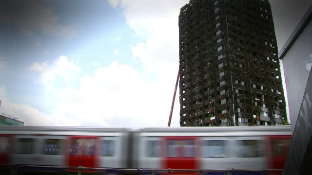 performance poet wants to use her words to help residents june 2017 ext fire blackened shell of grenfell tower as london underground train passes - poet stock videos & royalty-free footage