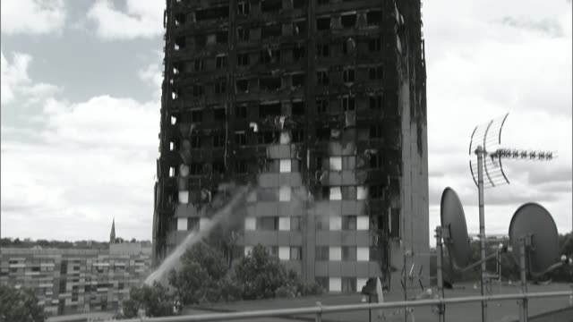 performance poet wants to use her words to help residents cutaway june 2017 ext water being hosed onto fire blackened shell of grenfell tower sheet... - poet stock videos & royalty-free footage