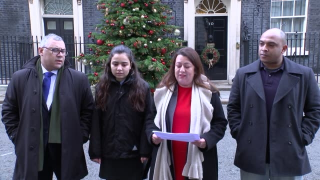 Petition delivered by families to Downing Street ENGLAND London Downing Street EXT Sandra Ruiz Karim Mussilhy and others delivering petition to...