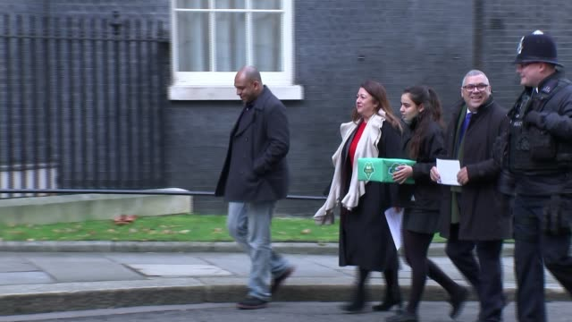 Petition delivered by families with request to overhaul inquiry ENGLAND London Downing Street EXT Sandra Ruiz Karim Mussilhy and others along with...