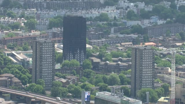 residents remain angry one month on as government threatens to take control of local council air view / aerial grenfell tower - jackie long stock videos & royalty-free footage