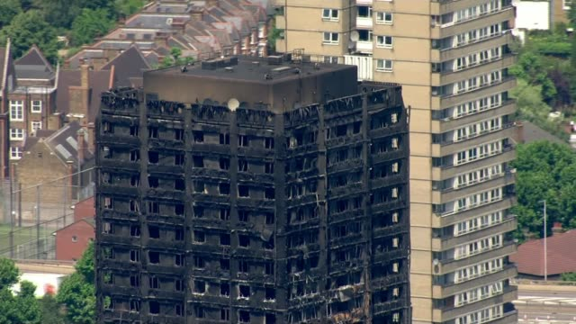 residents remain angry one month on as government threatens to take control of local council england london north kensington ext grenfell tower - jackie long stock videos & royalty-free footage