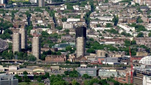 residents still not getting the support they need air view grenfell tower and surrounding area - surrounding stock videos and b-roll footage