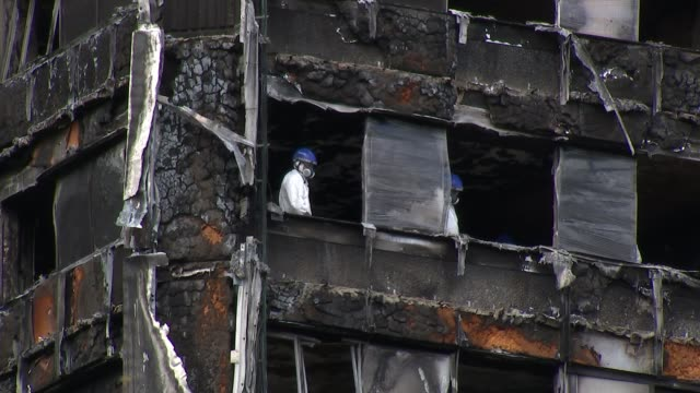 residents still not getting the support they need england london north kensington ext woman and child along with wreckage of firedestroyed grenfell... - itv london tonight weekend stock videos & royalty-free footage