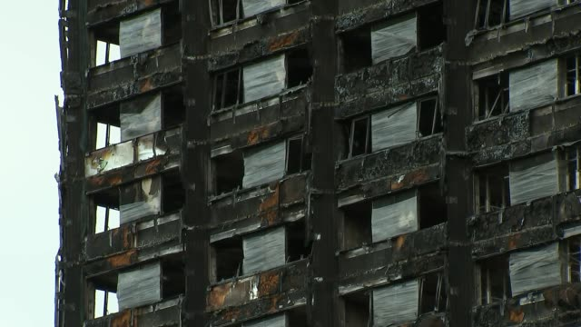 second person found guilty of fraudulently claiming to be a victim r010218014 / wide shot grenfell tower shell as tube train along past close shot... - window frame stock videos and b-roll footage