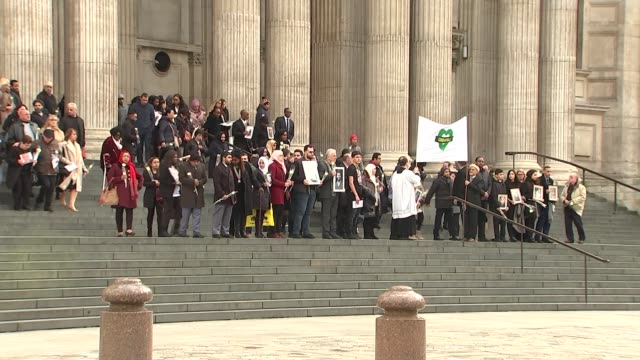 St Paul's Cathedral service on six month anniversary ENGLAND London St Paul's Cathedral EXT Bereaved relatives and survivors gathering on steps of...