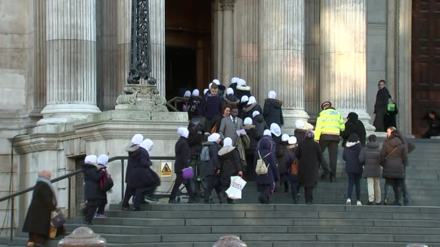St Paul's Cathedral service on six month anniversary ENGLAND London St Paul's Cathedral EXT Schools wearing headscarves along up steps into cathedral...